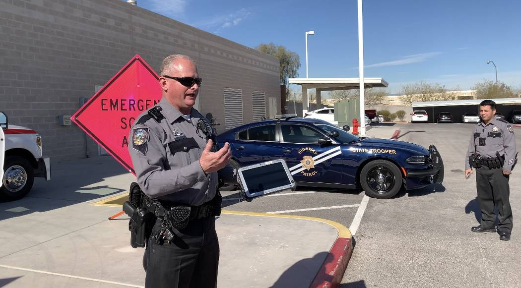 Nevada Highway Patrol troopers Clifford Fontaine and John Arias explain the benefit of using the Waycare program at the Regional Transportation Commission of Southern Nevada's traffic management c ...