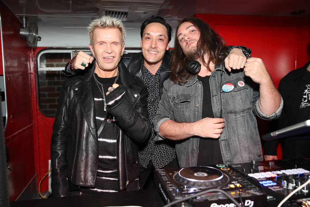 Billy Idol is shown with Mark Houston and DJ Cash during a stop at On The Record at Park MGM on Friday, Jan. 25, 2019 (Tony Tran).