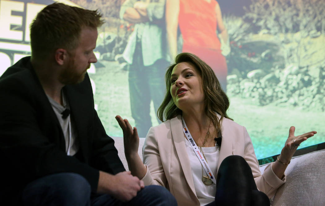"Eric and Lindsey Bennett, stars of HGTV's ""Desert Flippers"" speak during a panel on flipping houses during the second day of the Las Vegas Market held at the World Market Center in Las Vegas, Mond ..."