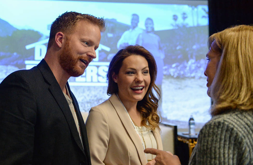 "Eric and Lindsey Bennett, stars of HGTV's ""Desert Flippers"" speak with Cheryl Jones after a panel on flipping houses during the second day of the Las Vegas Market held at the World Market Center i ..."
