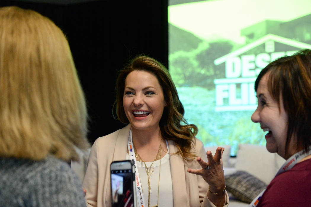 "Lindsey Bennett, one of the stars of HGTV's ""Desert Flippers"" speaks with attendees after a panel on flipping houses during the second day of the Las Vegas Market held at the World Market Center i ..."