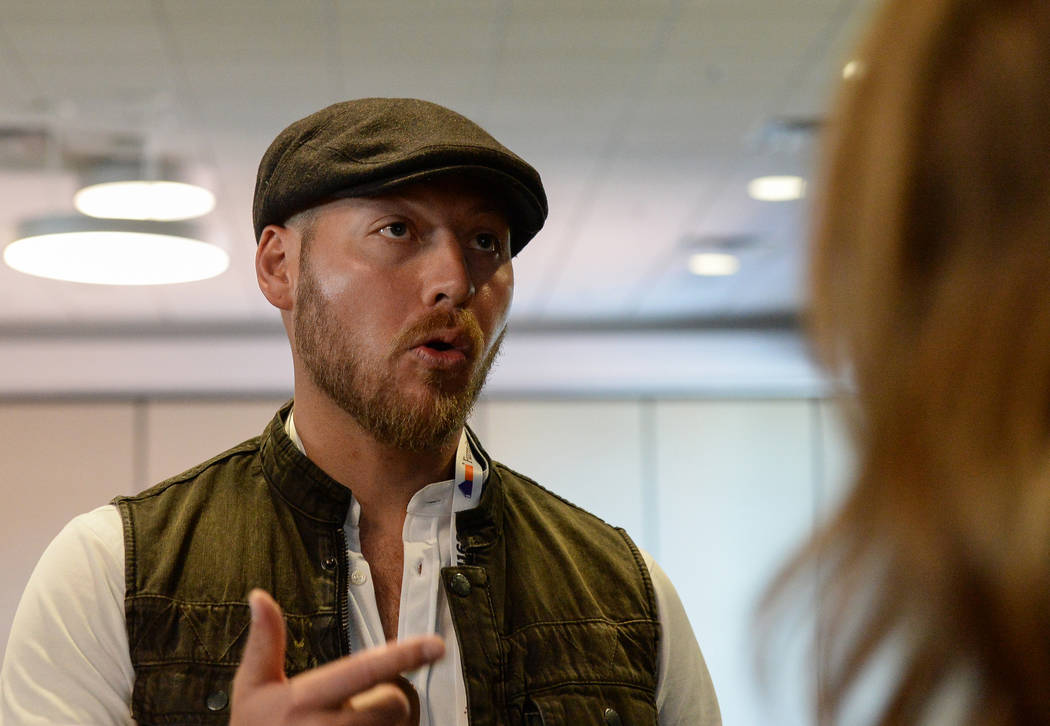 "Jordan Betten, a local house flipper in Henderson, speaks with Eric and Lindsey Bennett, stars of HGTV's ""Desert Flippers"" after a panel on flipping houses during the second day of the Las Vegas M ..."
