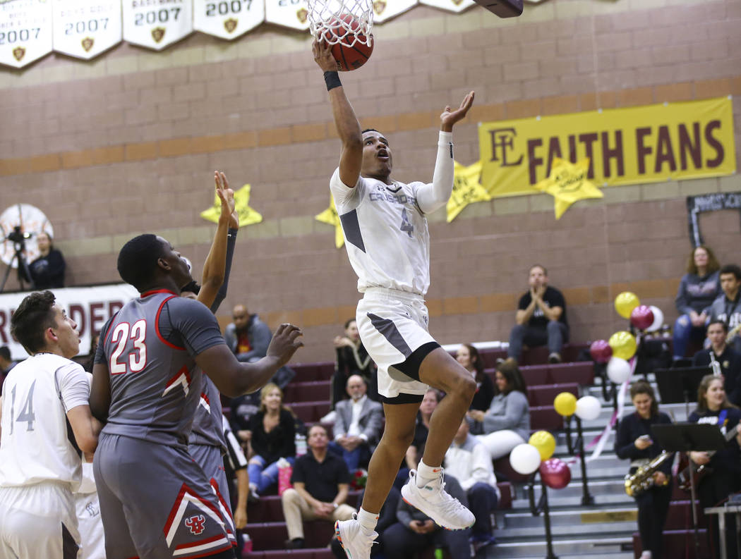 Faith Lutheran's Sedrick Hammond (4) goes to the basket past Arbor View's Jaylon Lee (23) during the second half of a basketball game at Faith Lutheran High School in Las Vegas on Thursday, Jan. 3 ...