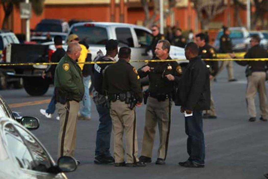 Las Vegas police investigate the scene on Feb. 8, 2013 near Clark High School where shooting suspect Roberto Torres was shot and killed by police. (Jeff Scheid/Las Vegas Review-Journal file)