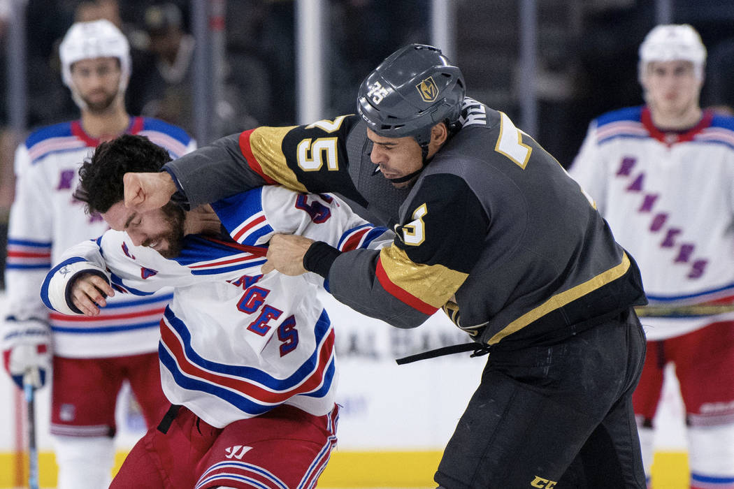 3f953998 Vegas Golden Knights right wing Ryan Reaves and New York Rangers defenseman  Adam McQuaid fight during