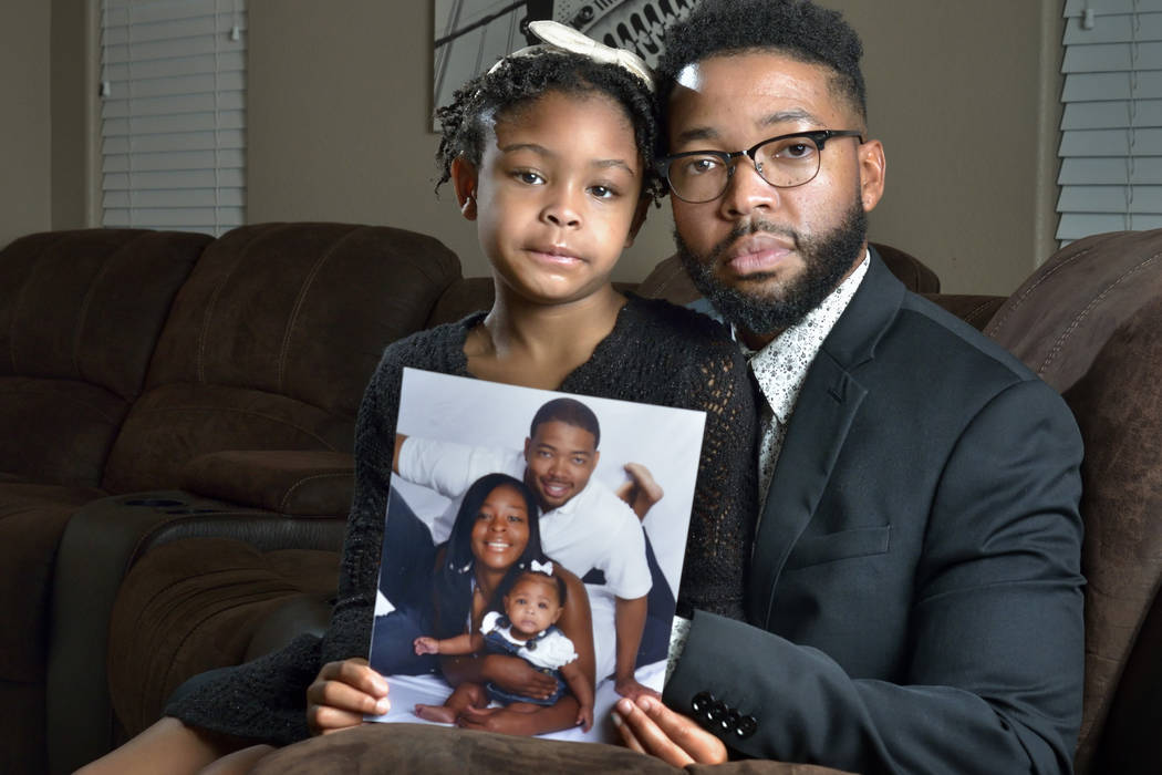 Brooklynn Murray, 7, is shown with her father Dwayne and a family portrait with her mother LaQuinta at their home in Las Vegas on Monday, Jan. 28, 2019. The Murrays won a $42 million settlement ag ...