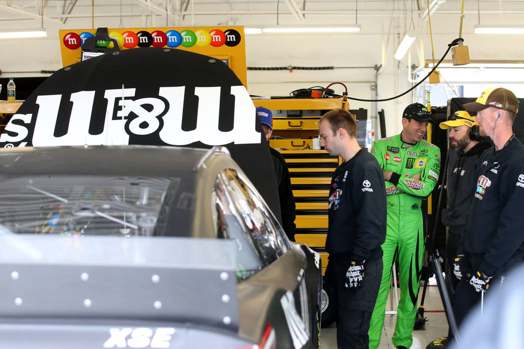 NASCAR driver and Las Vegas native Kyle Busch, center, in his garage during testing at Las Vegas Motor Speedway Thursday, Jan. 31, 2019. (K.M. Cannon/Las Vegas Review-Journal) @KMCannonPhoto
