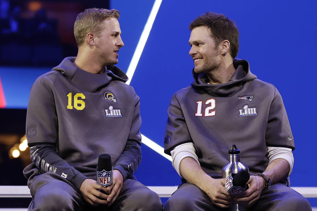 In this Monday, Jan. 28, 2019, file photo, Los Angeles Rams' Jared Goff talks to New England Patriots' Tom Brady during Opening Night for the NFL Super Bowl 53 football game in Atlanta. (AP Photo/ ...
