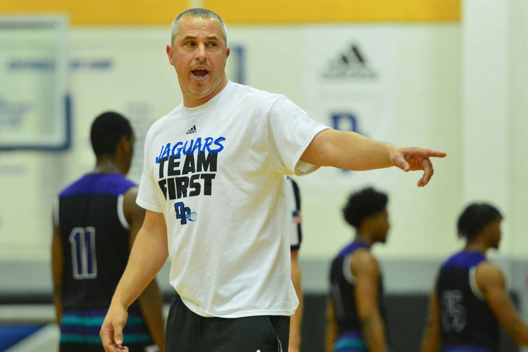 Desert Pines head coach Mike Uzan talks to his team during the fourth quarter of the Desert Pines vs. Silverado High School basketball game at Desert Pines High School in Las Vegas on Monday, Jan. ...