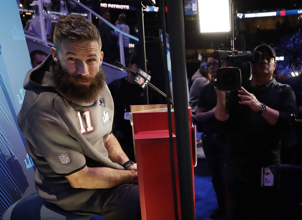 New England Patriots' Julian Edelman listens during Opening Night for the NFL Super Bowl 53 football game Monday, Jan. 28, 2019, in Atlanta. (AP Photo/David J. Phillip)