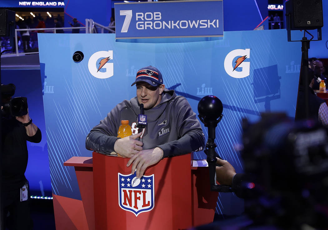 New England Patriots' Rob Gronkowski answers questions during Opening Night for the NFL Super Bowl 53 football game Monday, Jan. 28, 2019, in Atlanta. (AP Photo/Matt Rourke)