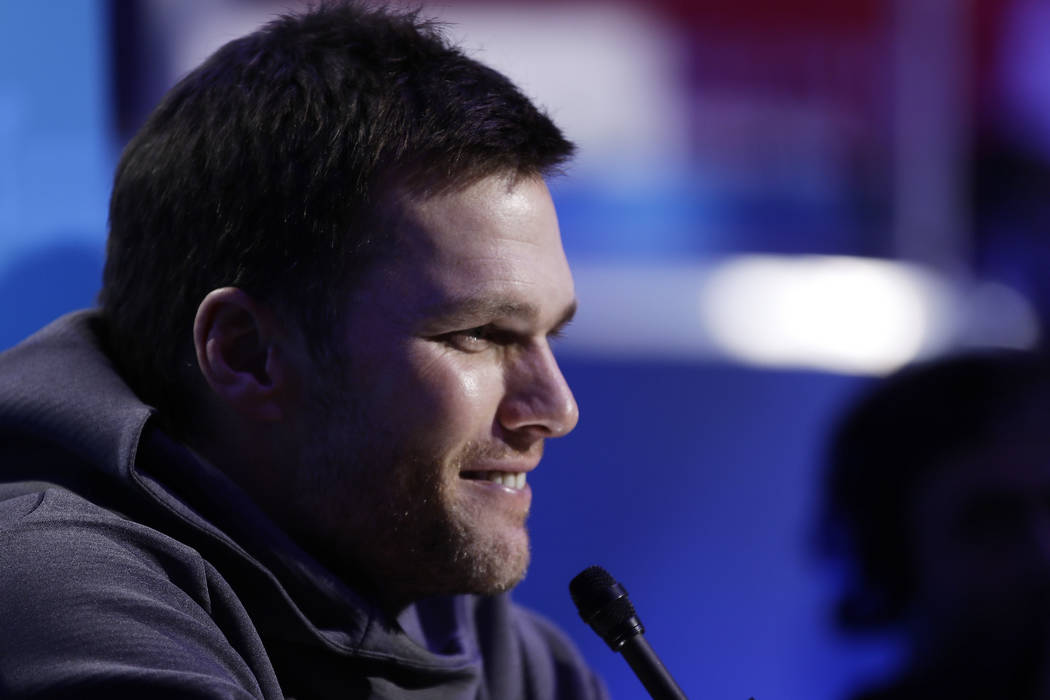 New England Patriots' Tom Brady answers a question during Opening Night for the NFL Super Bowl 53 football game Monday, Jan. 28, 2019, in Atlanta. (AP Photo/Matt Rourke)