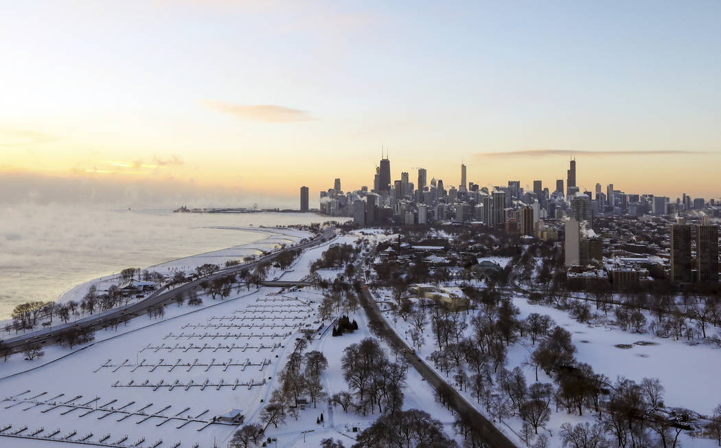Chicago's lakefront is covered with ice on Wednesday, Jan. 30, 2019. Temperatures are plummeting in Chicago as officials warn against venturing out into the dangerously cold weather. (AP Photo/Te ...