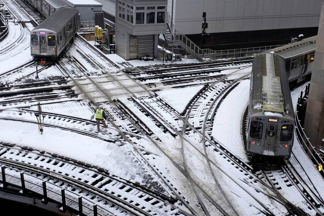 Chicago's El trains move along snow-covered tracks Monday, Jan. 28, 2019, in Chicago. The plunging temperatures expected later this week that have forecasters especially concerned. Wind chills cou ...