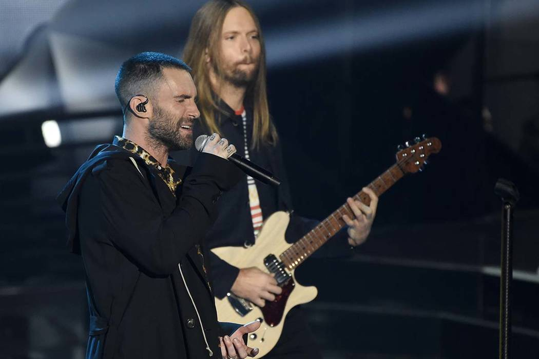 In this Sunday, March 11, 2018 file photo, Adam Levine, left, and James Valentine of Maroon 5 perform during the 2018 iHeartRadio Music Awards at The Forum in Inglewood, Calif. Maroon 5 has cancel ...
