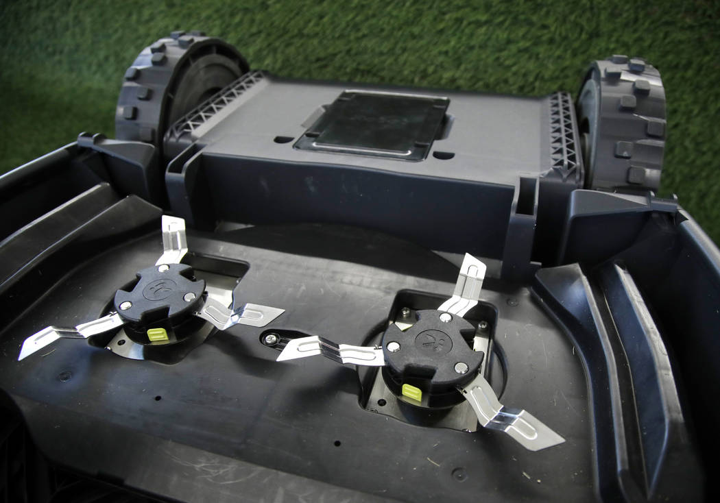 This Wednesday, Jan. 16, 2019 photo shows the underside of an iRobot Terra lawn mower in Bedford, Mass. Building a robot lawn mower seemed the logical next step for iRobot, which invented the pion ...