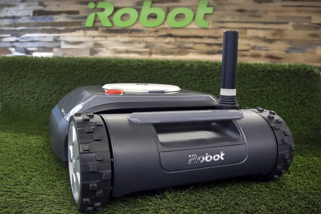 This Wednesday, Jan. 16, 2019 photo shows an iRobot Terra lawn mower in Bedford, Mass. Building a robot lawn mower seemed the logical next step for iRobot, which invented the pioneering robotic va ...