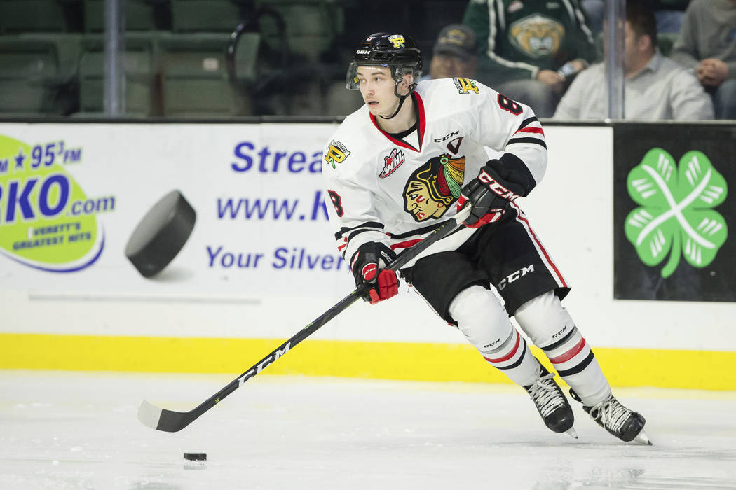 EVERETT, WA - NOVEMBER 14: Forward Cody Glass of the Portland Winterhawks (8) circles with the puck in the second period during a game between the Portland Winterhawks and the Everett Silvertips o ...