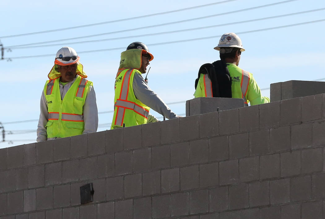 Workers lay concrete block at the construction site at the northeast corner of Fort Apache and Russell roads on Wednesday, Jan, 30, 2019, in Las Vegas. (Bizuayehu Tesfaye/Las Vegas Review-Journal) ...