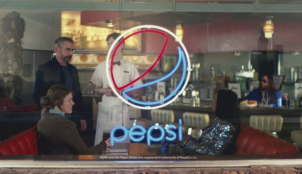 This screen grab from video provided by PepsiCo shows an image from the company's 2019 Super Bowl NFL football spot featuring Steve Carell, Cardi B and Lil Jon. Star power abounds in this year&#x2 ...