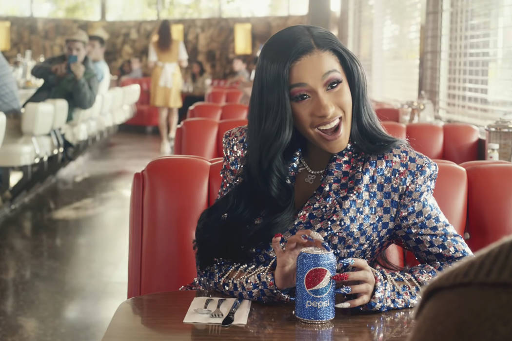 This screen grab from video provided by PepsiCo shows an image from the company's 2019 Super Bowl NFL football spot featuring Cardi B. Star power abounds in this year's Super Bowl ads. (Pep ...