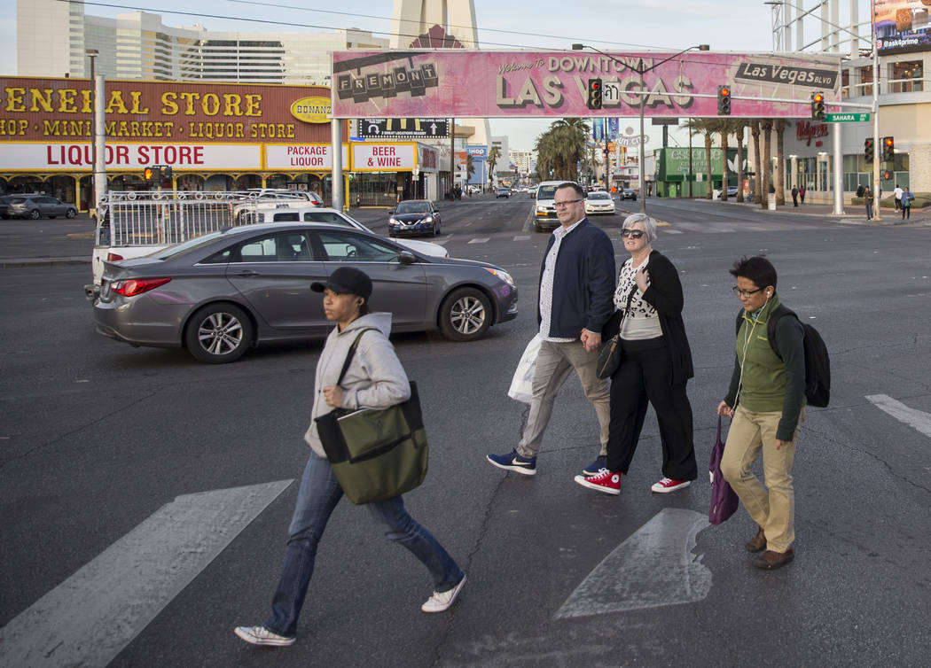 Pedestrians cross Sahara Avenue at Las Vegas Boulevard during rush hour traffic on Wednesday, Jan. 30, 2019, in Las Vegas. (Benjamin Hager/Las Vegas Review-Journal) @BenjaminHphoto
