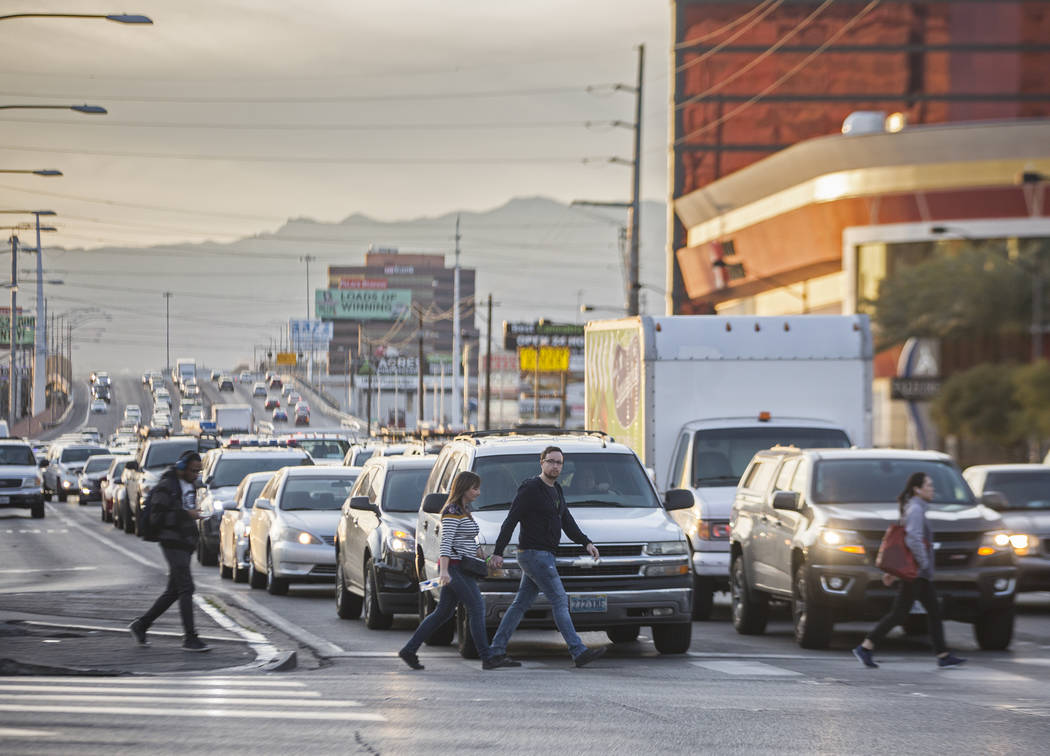 Pedestrians cross Las Vegas Boulevard at Sahara Avenue during rush hour traffic on Wednesday, Jan. 30, 2019, in Las Vegas. (Benjamin Hager/Las Vegas Review-Journal) @BenjaminHphoto