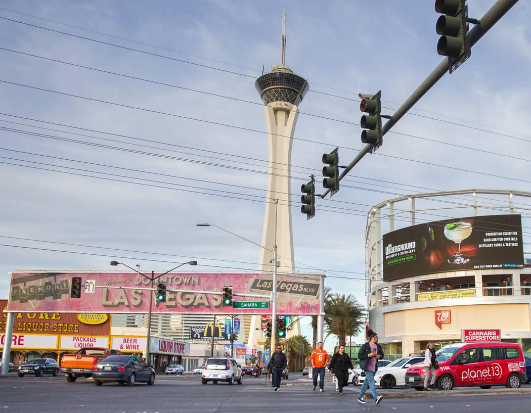 Pedestrians cross Sahara Avenue at Las Vegas Boulevard during rush hour traffic on Wednesday, Jan. 30, 2019, in Las Vegas. (Benjamin Hager/Las Vegas Review-Journal) @BenjaminHphoto
