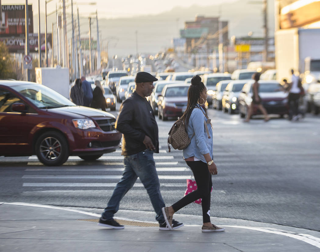 Pedestrians wait to cross Las Vegas Boulevard at Sahara Avenue during rush hour traffic on Wednesday, Jan. 30, 2019, in Las Vegas. (Benjamin Hager/Las Vegas Review-Journal) @BenjaminHphoto