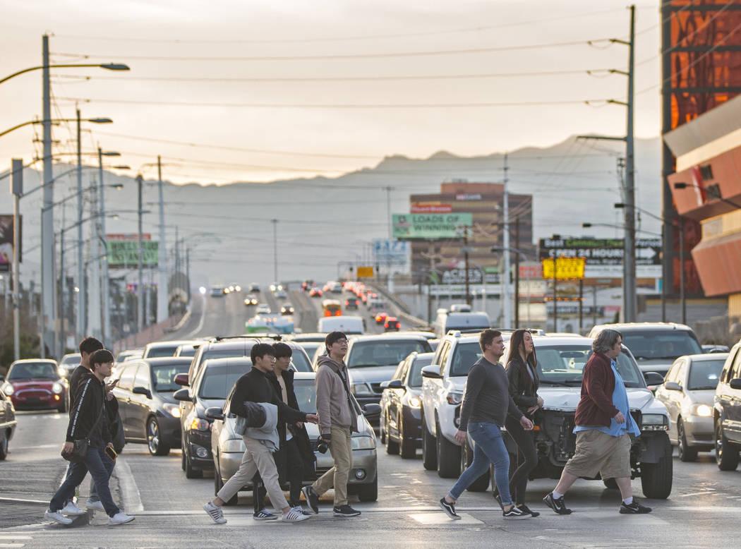 Pedestrians cross Las Vegas Boulevard at Sahara Avenue during rush hour traffic on Wednesday, Jan. 30, 2019, in Las Vegas. (Benjamin Hager/Las Vegas Review-Journal) @BenjaminHphoto