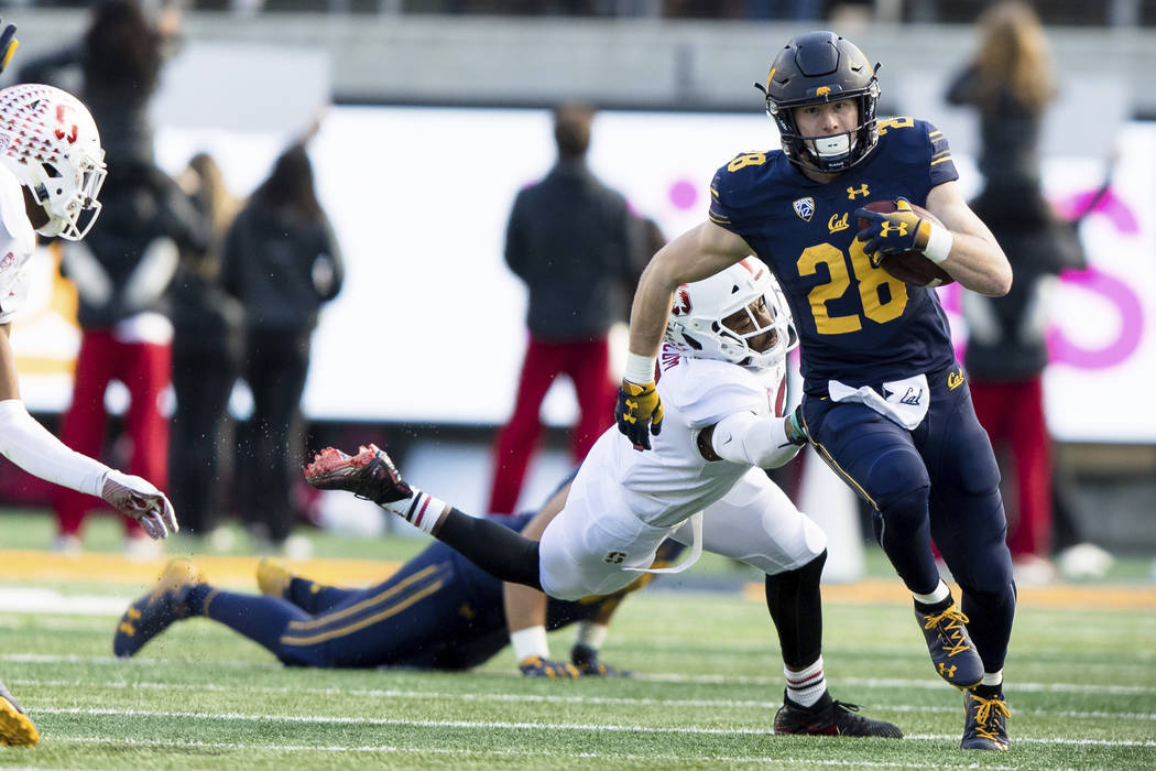 California Golden Bears running back Biaggio Ali Walsh (26) runs the ball against the Stanford Cardinal in the second quarter of a football game in Berkeley, Calif., Saturday, Dec. 1, 2018. (AP Ph ...