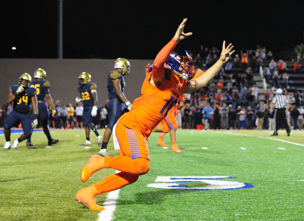 Bishop Gorman quarterback Tate Martell (18) reacts after Bishop Gorman running back Biaggio Ali Walsh scored the winning 2-point conversion in triple overtime against St. Thomas Aguinas, Fla. dur ...