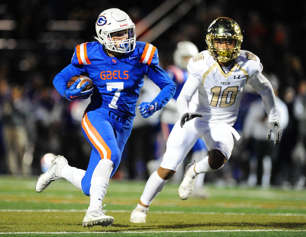Bishop Gorman running back Biaggio Ali Walsh (7) rushes for a touchdown as Faith Lutheran Faith Lutheran safety Taimani Mckenzie defends in the first half of their prep football game at Bishop Gor ...