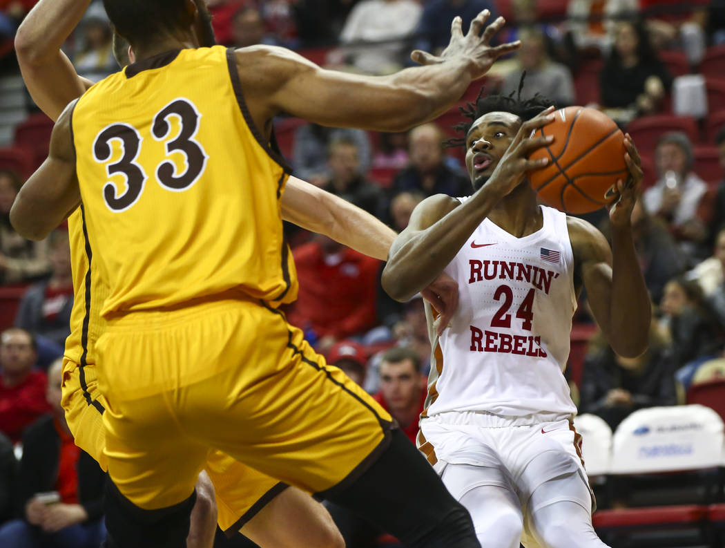 UNLV Rebels forward Joel Ntambwe (24) looks to pass the ball during the second half of a basketball game against Wyoming at the Thomas & Mack Center in Las Vegas on Saturday, Jan. 5, 2019. Cha ...