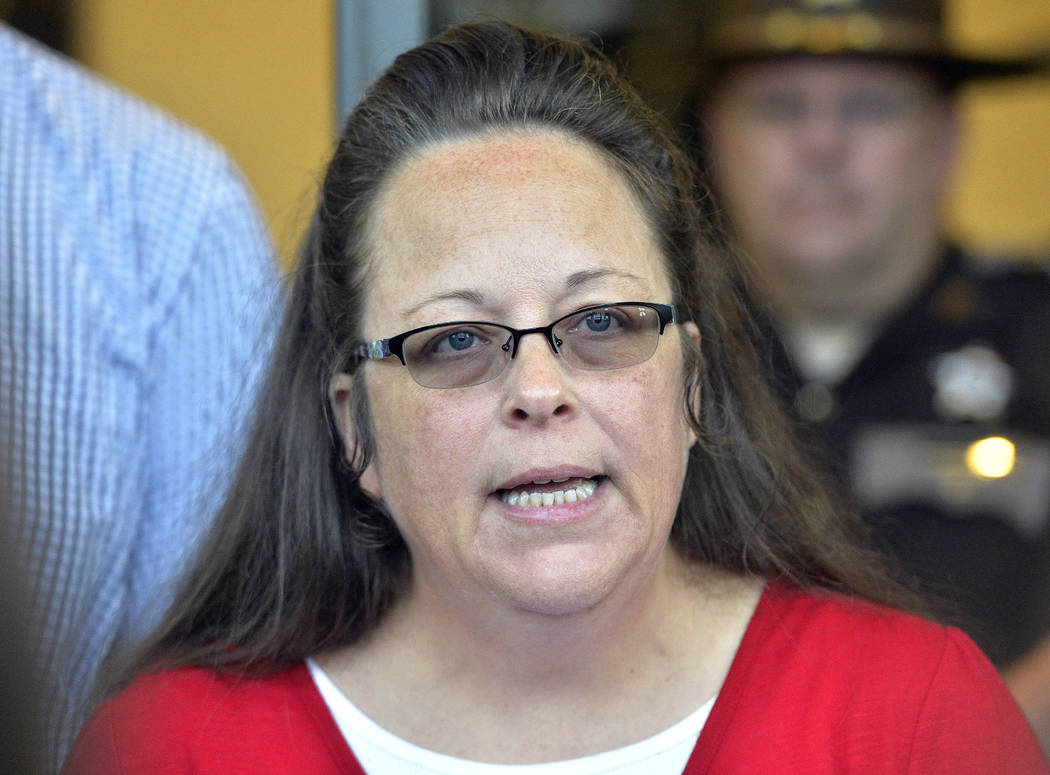 FILE - In this Sept. 14, 2015, file photo, Rowan County Clerk Kim Davis makes a statement to the media at the front door of the Rowan County Judicial Center in Morehead, Ky. Outside attorneys for ...