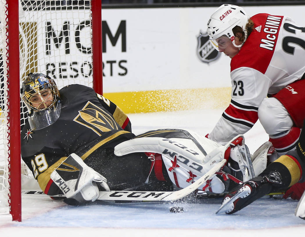 Golden Knights goaltender Marc-Andre Fleury (29) blocks the puck as Carolina Hurricanes left wing Brock McGinn (23) tries to get it in during the second period of an NHL hockey game at T-Mobile Ar ...