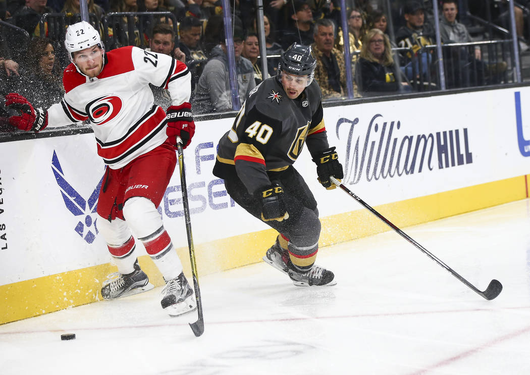 Carolina Hurricanes defenseman Brett Pesce (22) moves the puck past Golden Knights center Ryan Carpenter (40) during the third period of an NHL hockey game at T-Mobile Arena in Las Vegas on Saturd ...