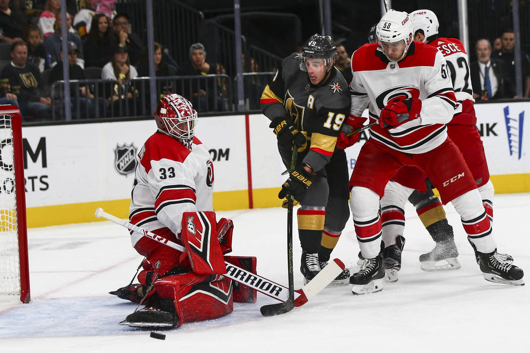 Golden Knights right wing Reilly Smith (19) tries to get the puck in against Carolina Hurricanes goaltender Scott Darling (33) during the first period of an NHL hockey game at T-Mobile Arena in La ...