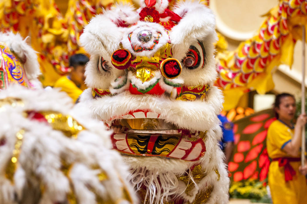 "Members of Yau Kung Moon Kung Fu Dragon and Lion Dance perform a traditional lion dance to celebrate the Chinese New Year and the start to the ""Year of the Dog"" at The Venetian in Las Ve ..."