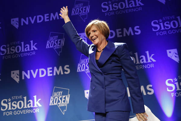 Susie Lee, a Democratic candidate for Nevada's third congressional district, takes the stage at a Democratic election night party Wednesday, Nov. 7, 2018, in Las Vegas. Lee was named chairman of t ...