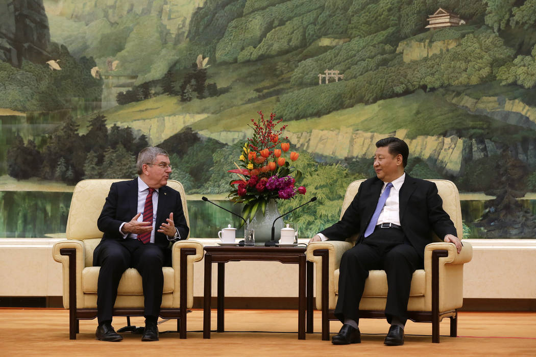 International Olympic Committee (IOC) President Thomas Bach, left, talks to Chinese President Xi Jinping during their meeting at the Great Hall of the People in Beijing, Thursday, Jan. 31, 2019. ( ...