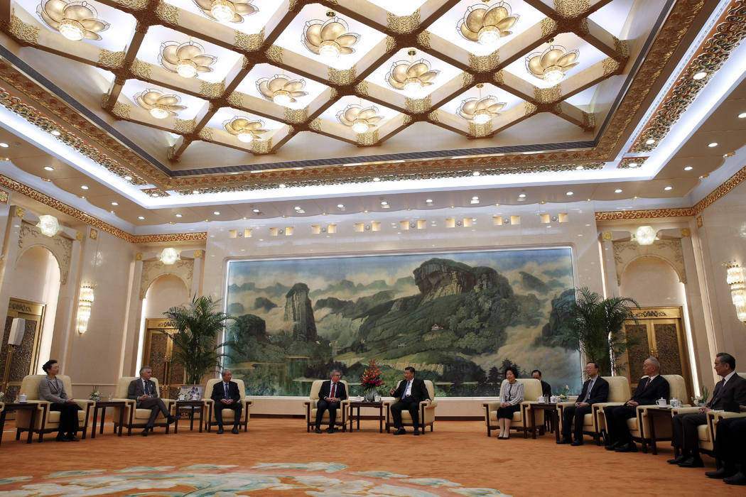 International Olympic Committee (IOC) President Thomas Bach, center left, talks with Chinese President Xi Jinping during their meeting at the Great Hall of the People in Beijing, Thursday, Jan. 31 ...
