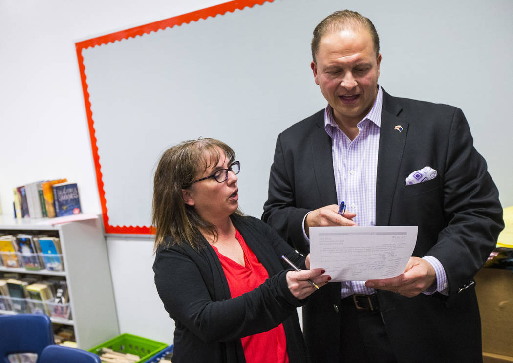 Gina Salazar, coordinator of the AVID program at Johnston Middle School, left, talks with Louis Markouzis, principal, in a classroom in North Las Vegas on Wednesday, Jan. 30, 2019. Chase Stevens L ...