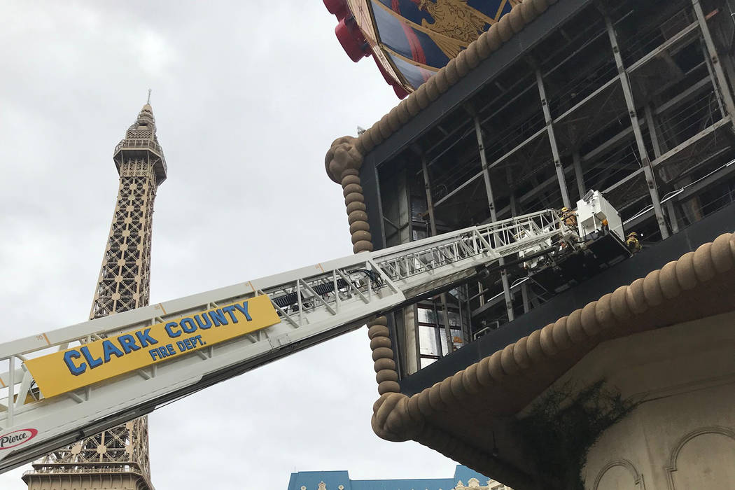 Clark County firefighters were working to rescue a man Thursday afternoon after he fell from the large balloon display at Paris Las Vegas. (Clark County Fire Department)