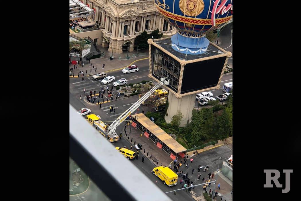 Clark County fire crews work to rescue a man after he fell from the large balloon display at Paris Las Vegas as seen from The Cosmopolitan. (Reginald Santos/Facebook)