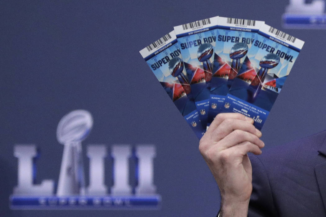 Michael, Buchwald, NFL Senior Counsel, Legal, holds up Super Bowl 53 tickets as he explains the security features on the tickets during a news conference for the NFL Super Bowl 53 football game Th ...