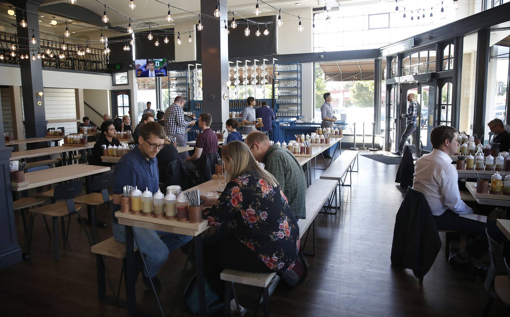 "In this May 9, 2018, file photo, customers dine at the Wursthall Restaurant & Bierhaus in San Mateo, Calif. Patrons won't be served at the Silicon Valley restaurant if they wear a ""Make America Gr ..."