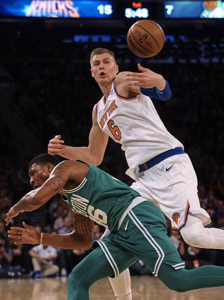 In this Dec. 21, 2017, file photo, New York Knicks' Kristaps Porzingis (6) battles for the ball with Boston Celtics' Marcus Smart during the first half of an NBA basketball game at Madison Square ...