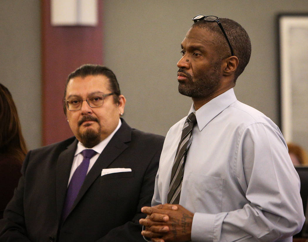 Emilio Arenas stands with his attorney Charles Cano, left, as the jury exits the courtroom for a recess during the closing arguments at the Regional Justice Center in Las Vegas in Las Vegas, Thurs ...