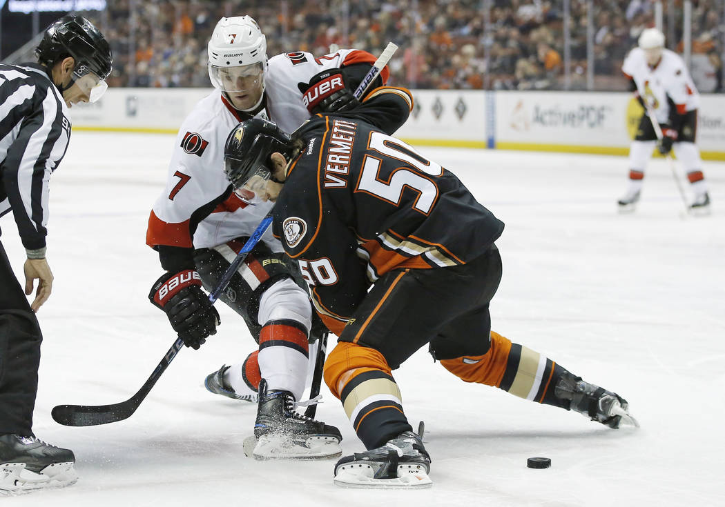 In this Dec. 11, 2016, file photo, Ottawa Senators center Kyle Turris (7) and Anaheim Ducks center Antoine Vermette (50) battle for position during a faceoff in the first period of an NHL hockey g ...